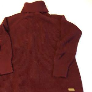 Michael Kors burgundy turtleneck sweater.